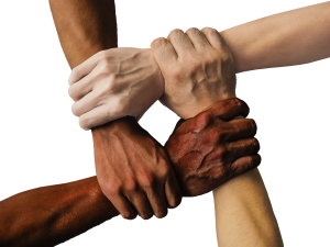 Three interlocking hands supporting each other