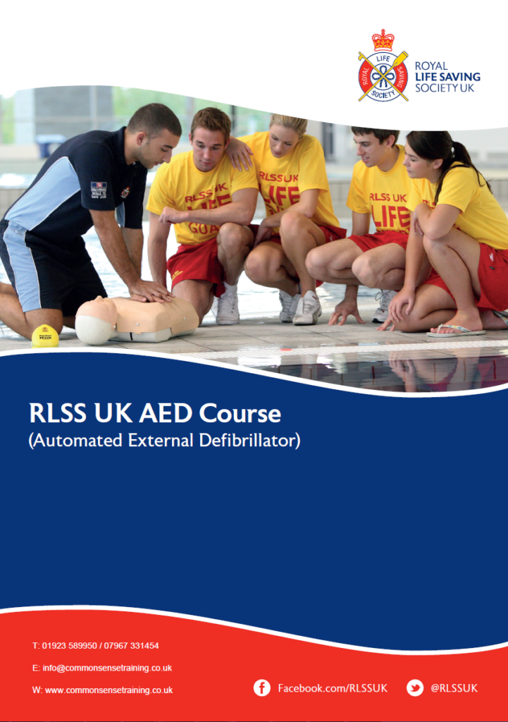 RLSS AED Course - Tutor demonstrating CPR on a manikin in front of four lifeguards