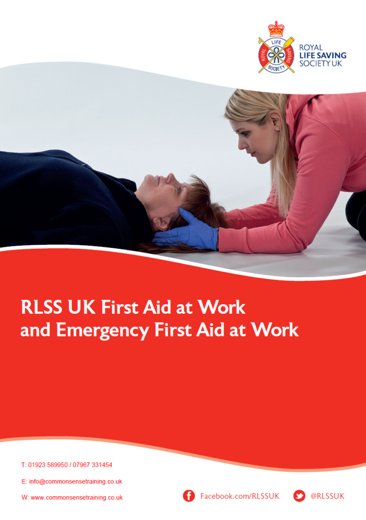 RLSS UK First Aid at Work / Emergency First Aid At Work - Female first aider supporting casualty head