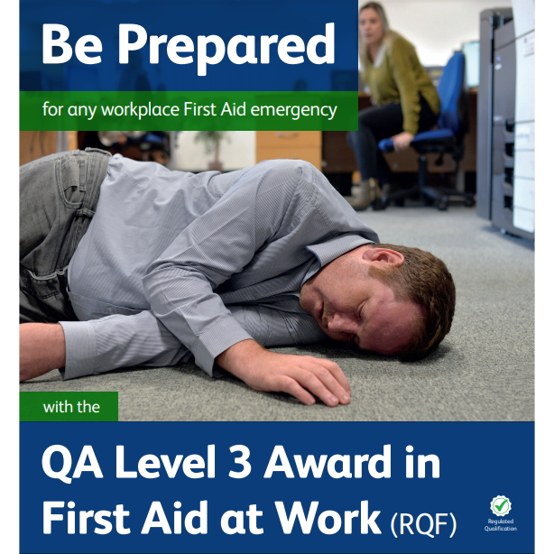 First Aid at Work - Male lying on the floor with a concerned female looking on