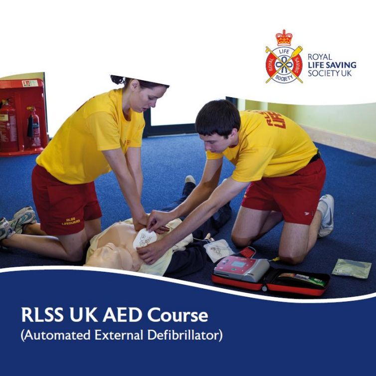 RLSS UK AED Course - Two lifeguards practising CPR and use of an AED on a manikin