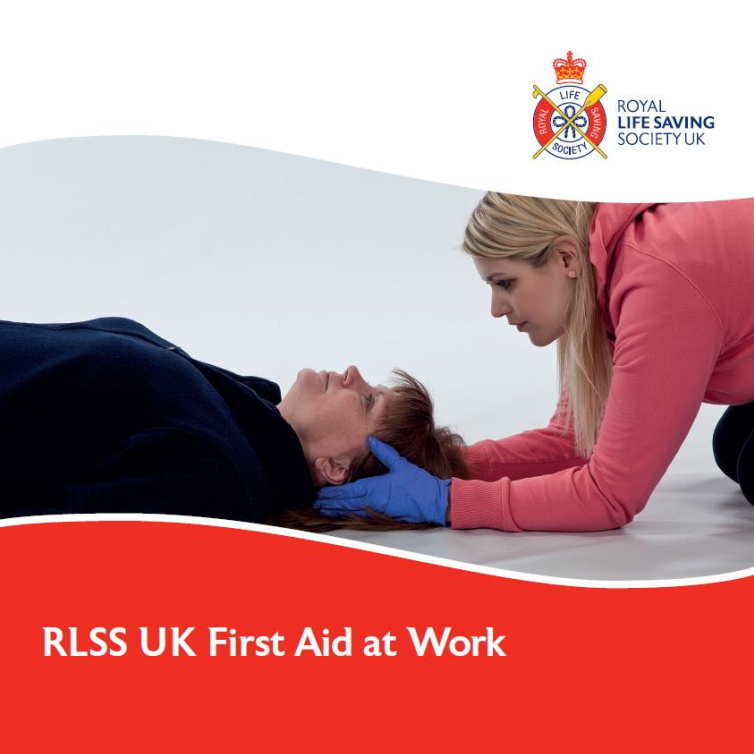 RLSS UK First Aid at Work - Female first aider supporting a female casualty head