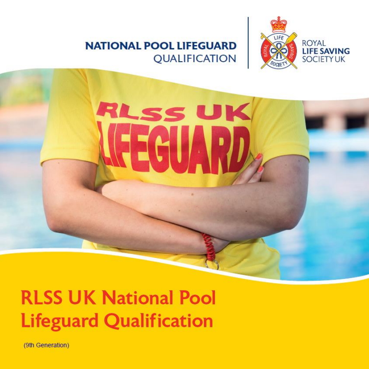 RLSS UK National Pool Lifeguard Qualification - Mid section of a lifeguard by a pool wearing a yellow t-shirt with arms folded