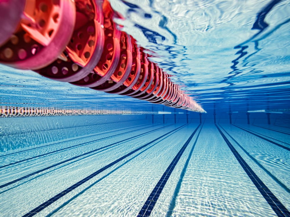 Underwater at an Olympic pool with a red lane rope visible