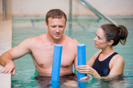 Man taking part in a hydrotherphy session with female instructor