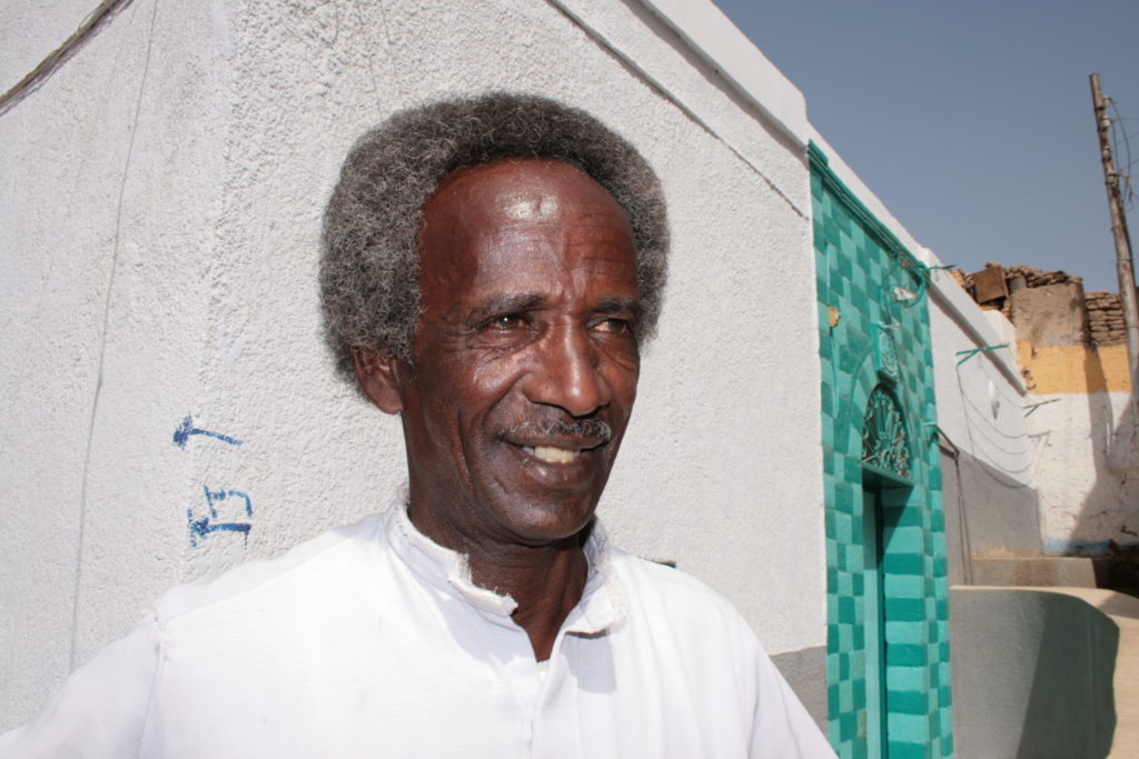 This guy = not a tout, actually (I didn't take any pictures of touts). He was a super friendly Nubian prince who gave us a tour of his village. Amazing guy!