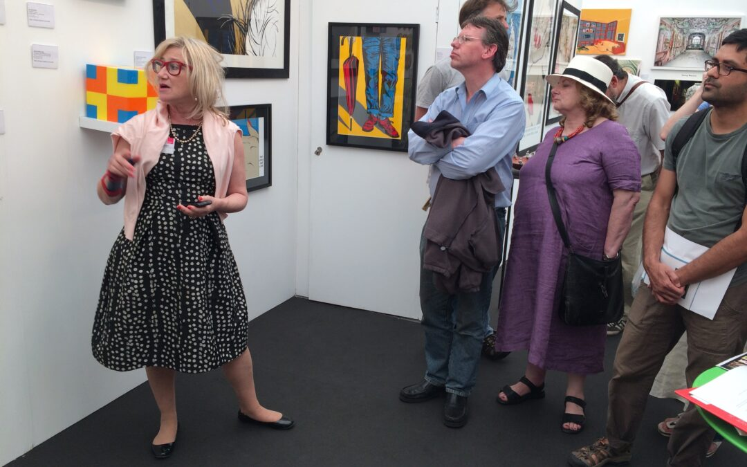 Cynthia Corbett introduces visitors to her fair stand