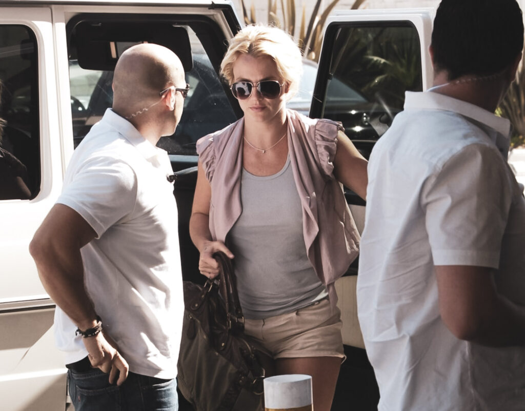 Britney Spears watched by security