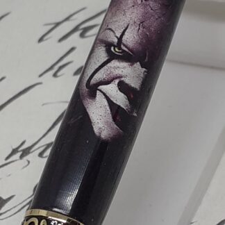 Clown image scary face twist pen finished in gold and gunmetal plating