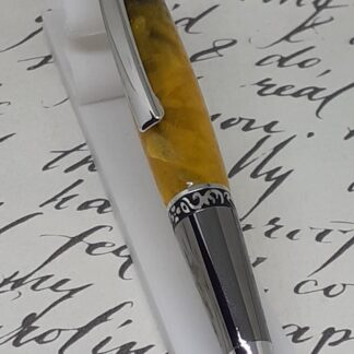 twist top pen,gunmetal plated components and gold color acrylics body.