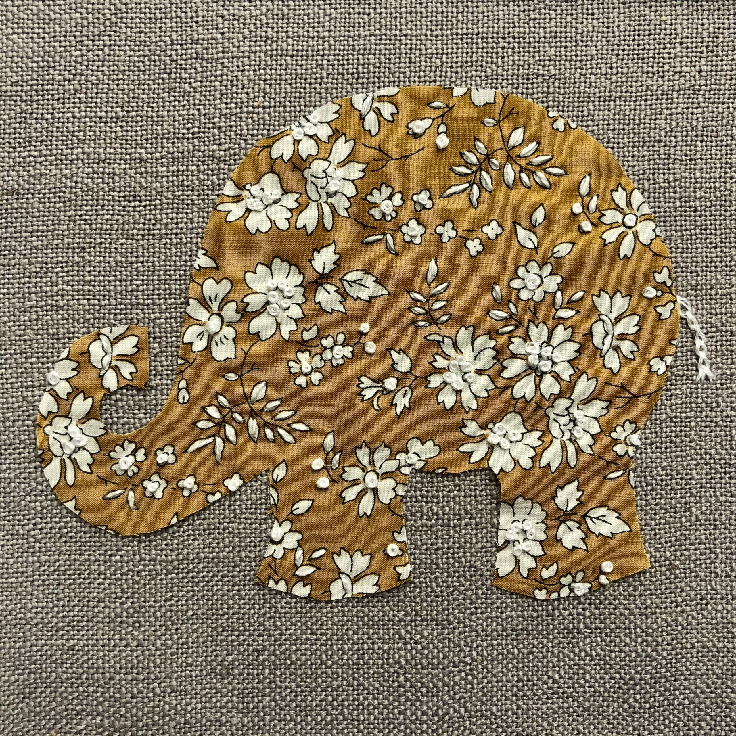 Close up of Liberty of London Elephant embroidered art