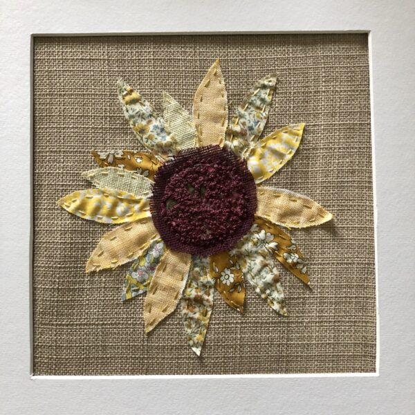 Close up of sunflower embroidered art