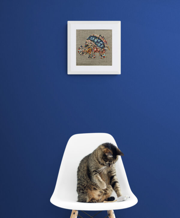 Bourton artwork above chair with cat