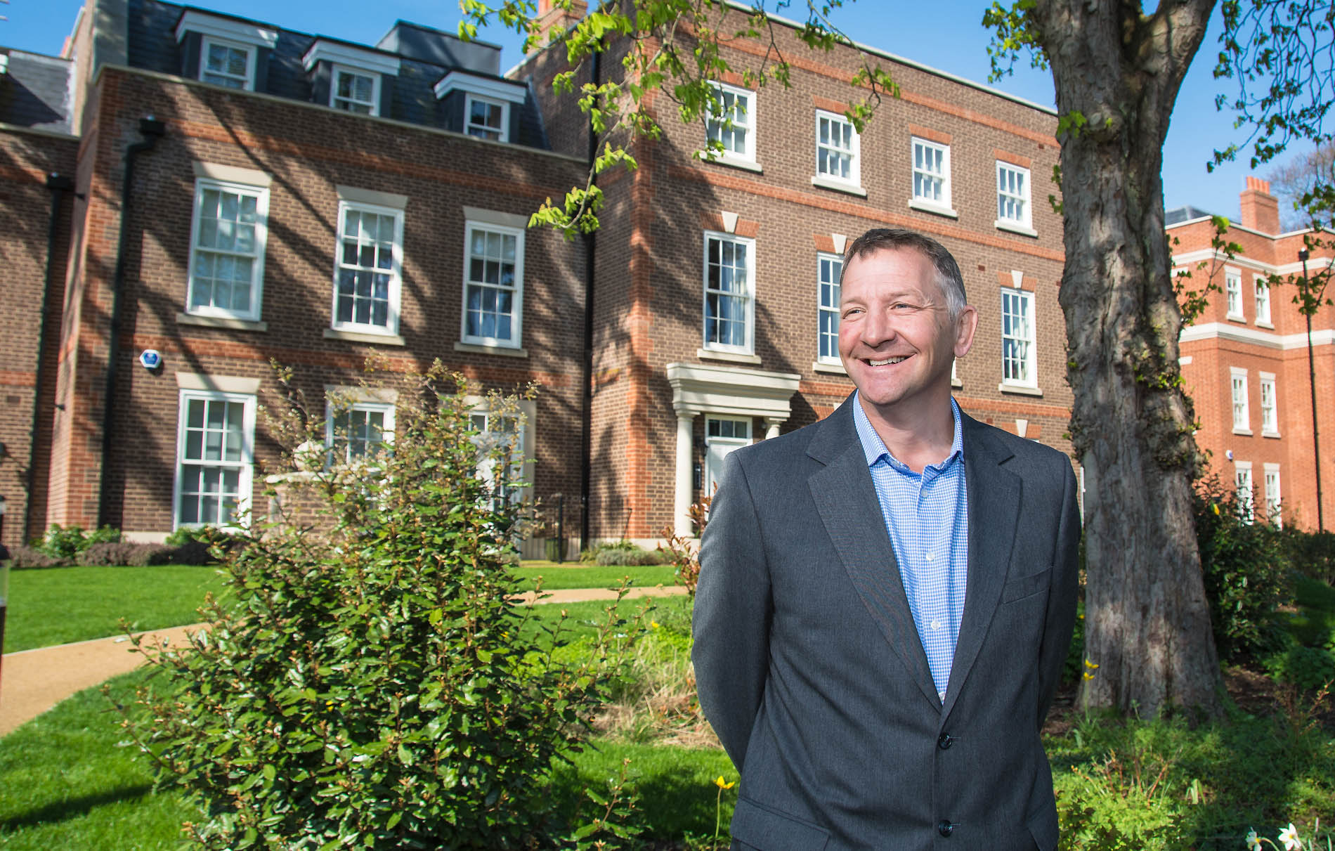 Web designers Belfast portfolio web site - photo 1216 of man in front of apartments by veetoo design Belfast, Northern Ireland, UK.