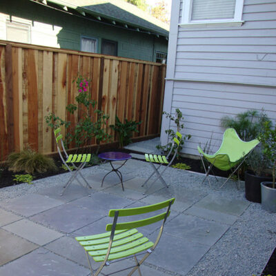 Natural stone and gravel patio lawn alternative plants only on edge saves water