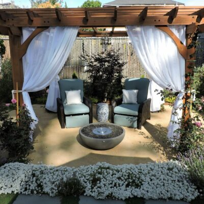 Pergola fire feature gold DG patio flagstone lush garden