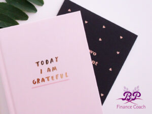pink journal, gratitude and finance