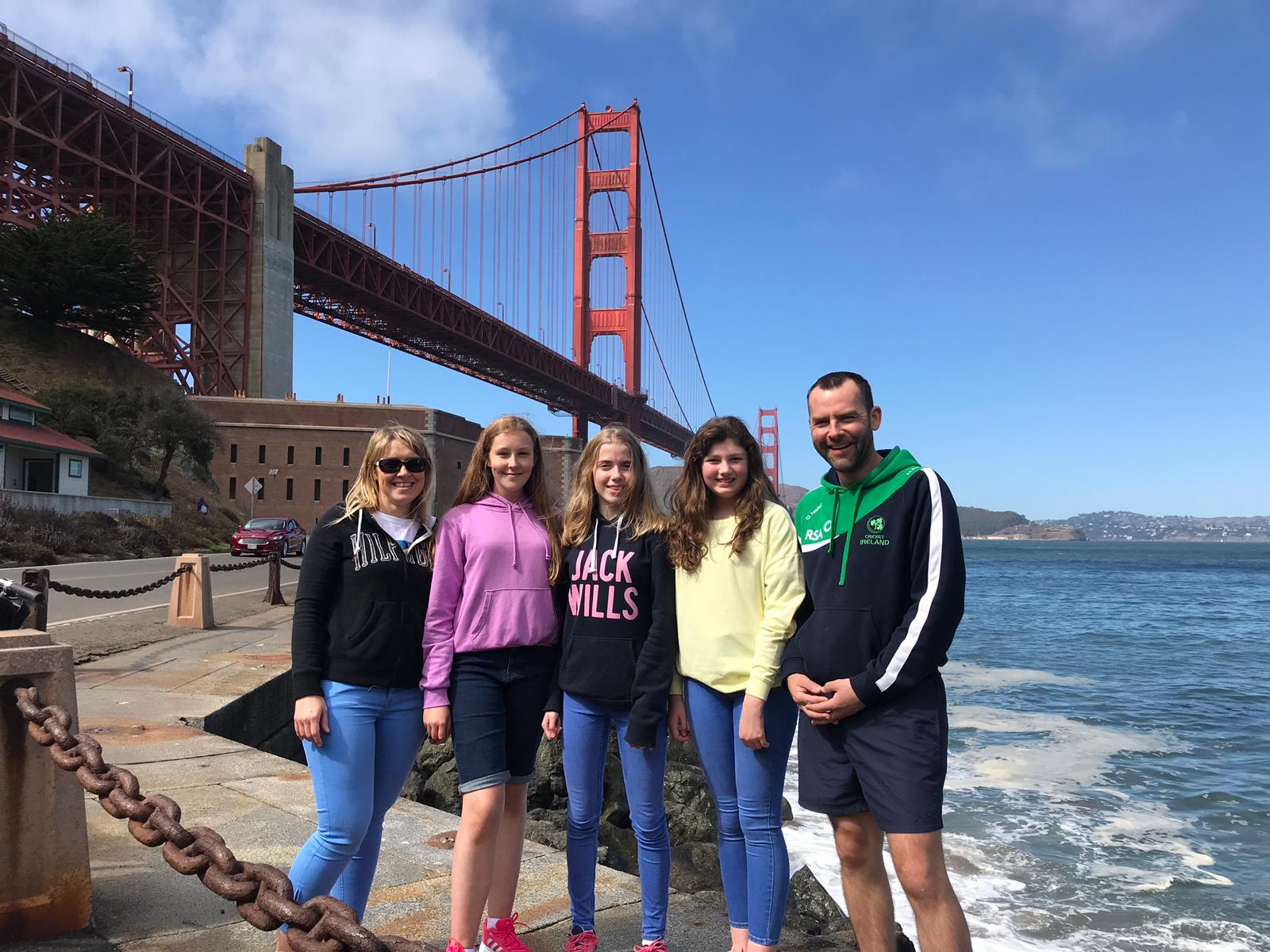 Chloe, Jessica and Lana with their teachers enjoying a quick photo op under the world famous Golden Gate Bridge.