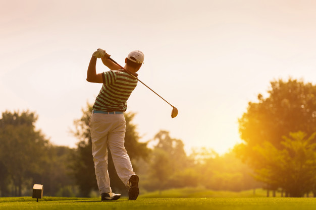 golfers-hit-sweeping-golf-course-summer_46139-223
