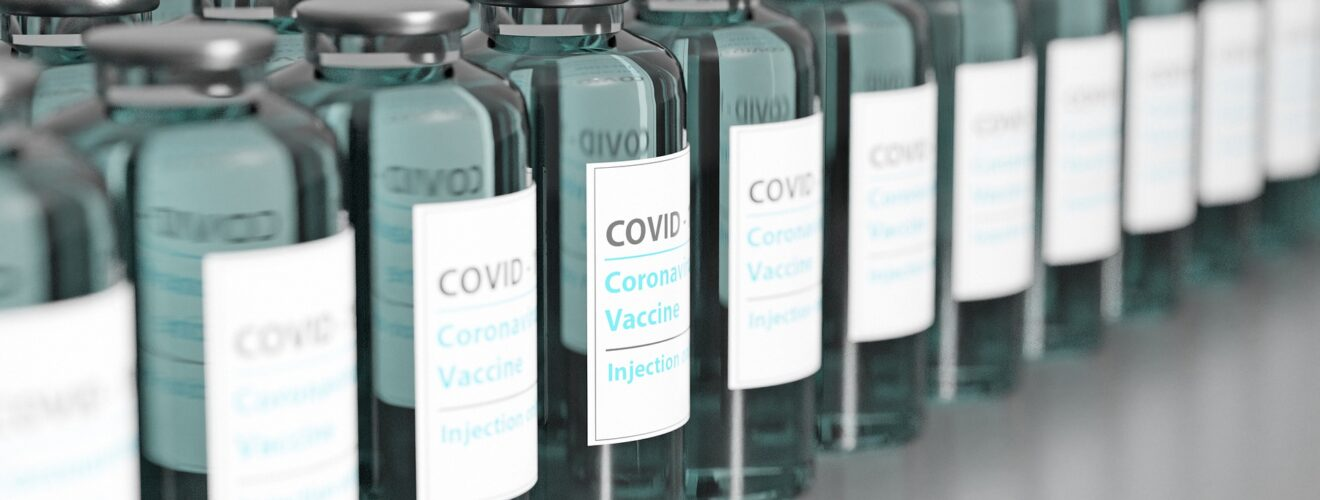 A line of bottles containing COVID-19 vaccine