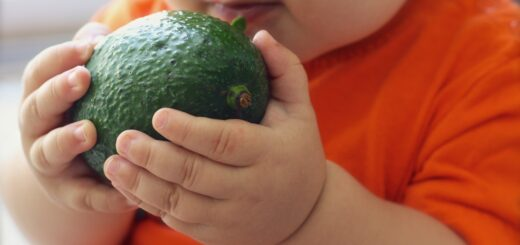 a baby with an avocado