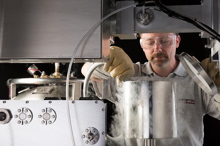 User filling the liquid nitrogen dewar on the J105 SIMS