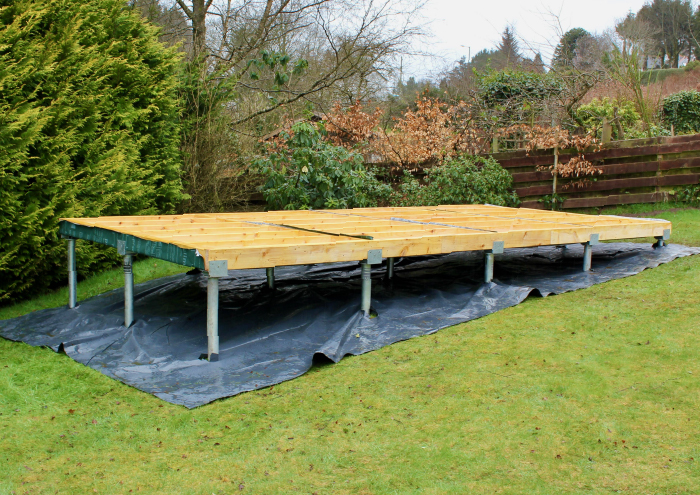 ground screw foundations on sloping ground with timre-frame base
