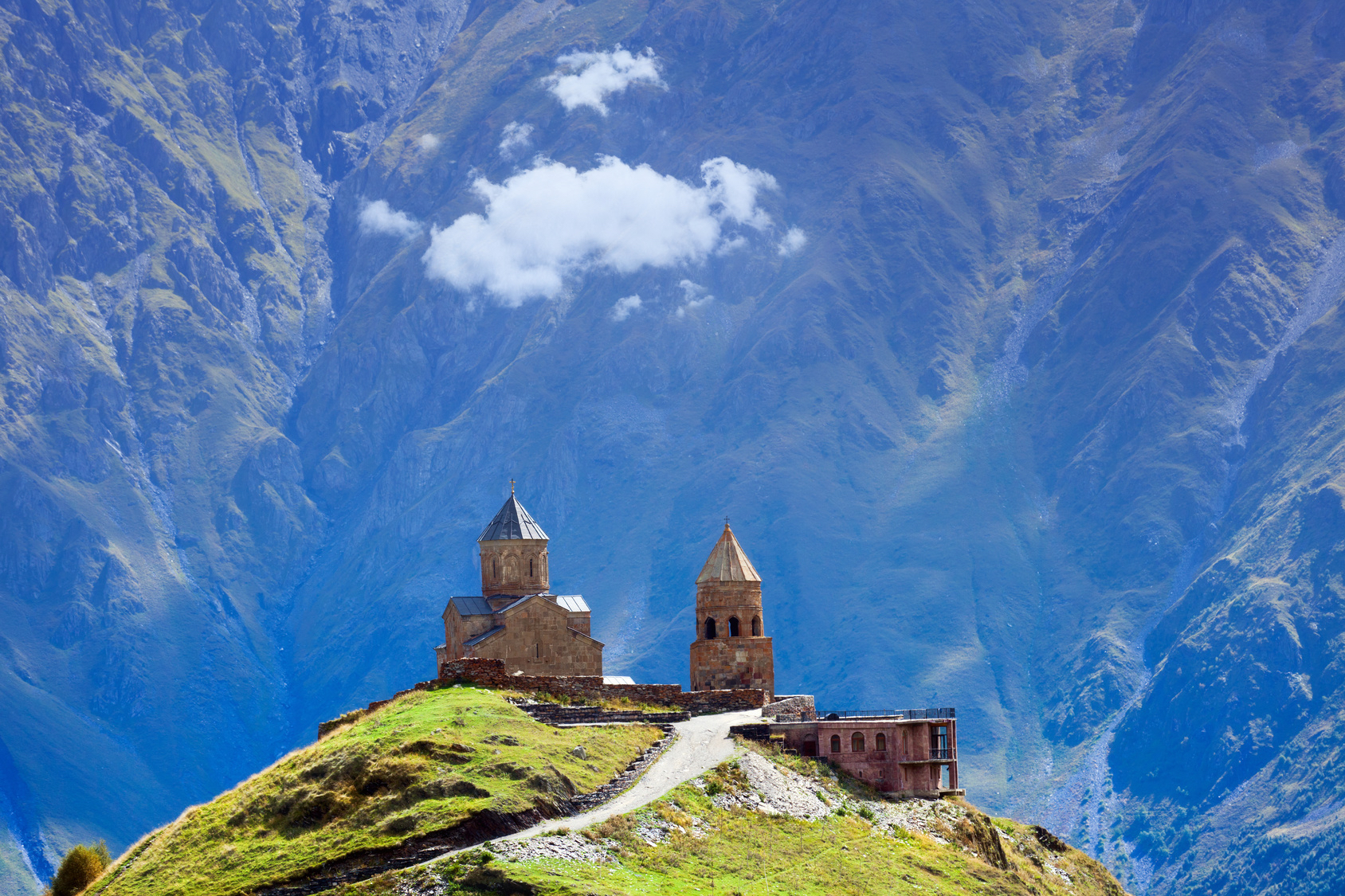 Gergeti Christian church near Kazbegi, Stepancminda village in Georgia, Caucasus