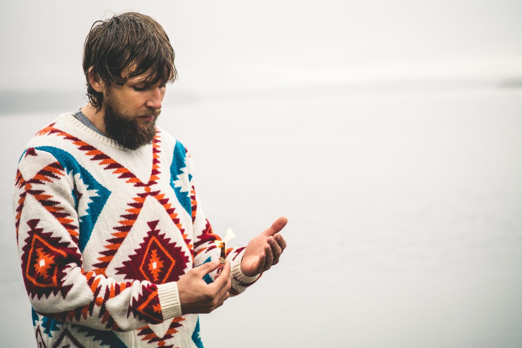 Man bearded holding fire