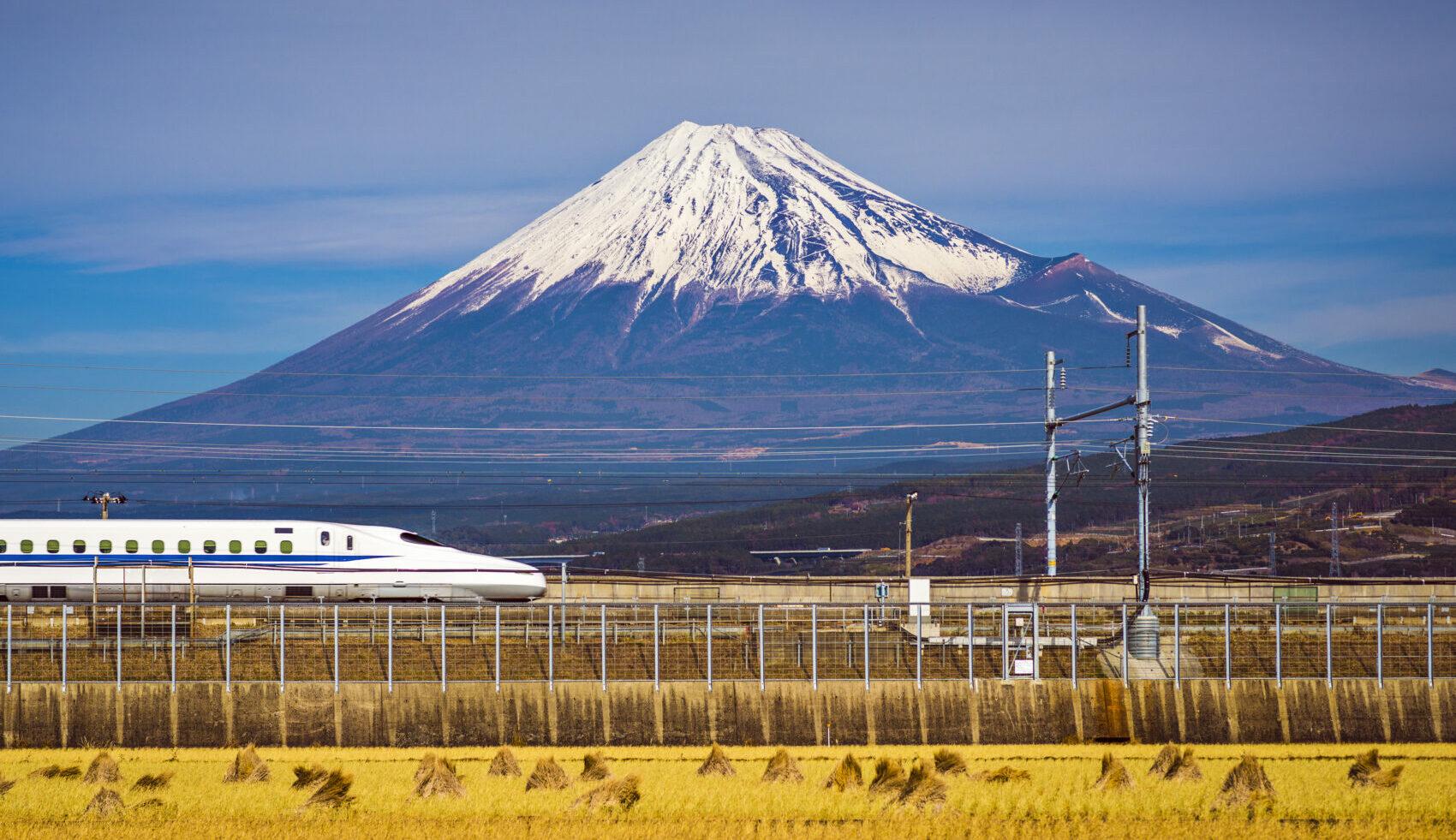 Bullet train passing Mount Fuji