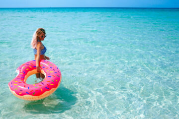 Woman in sea with inflatable doughnut