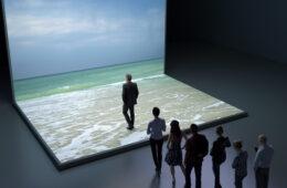 People walking into virtual sea