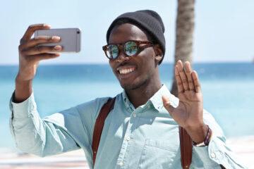 Man on beach doing video call