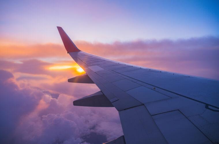 Plane wing sunset sky