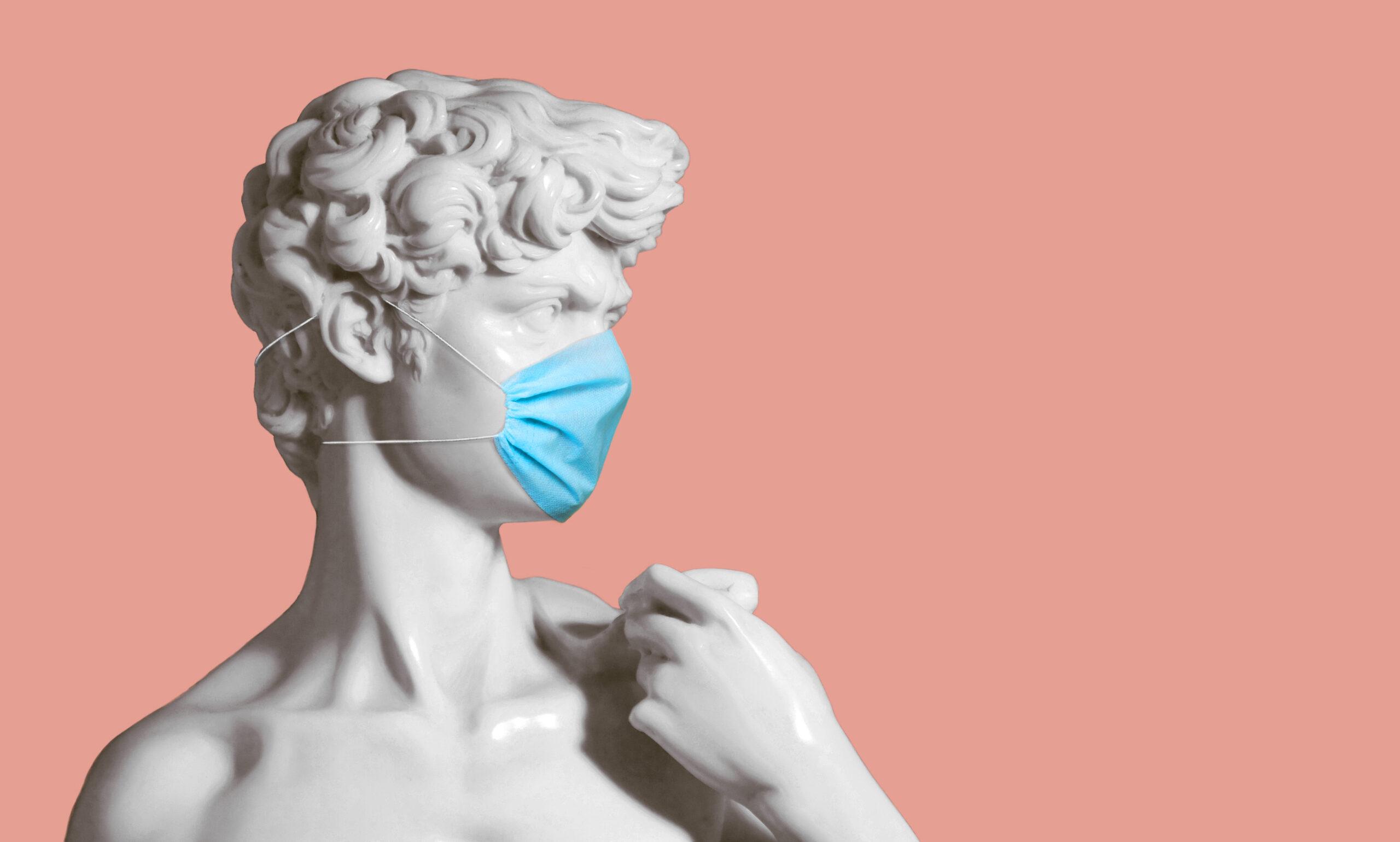 Sculpture wearing mask