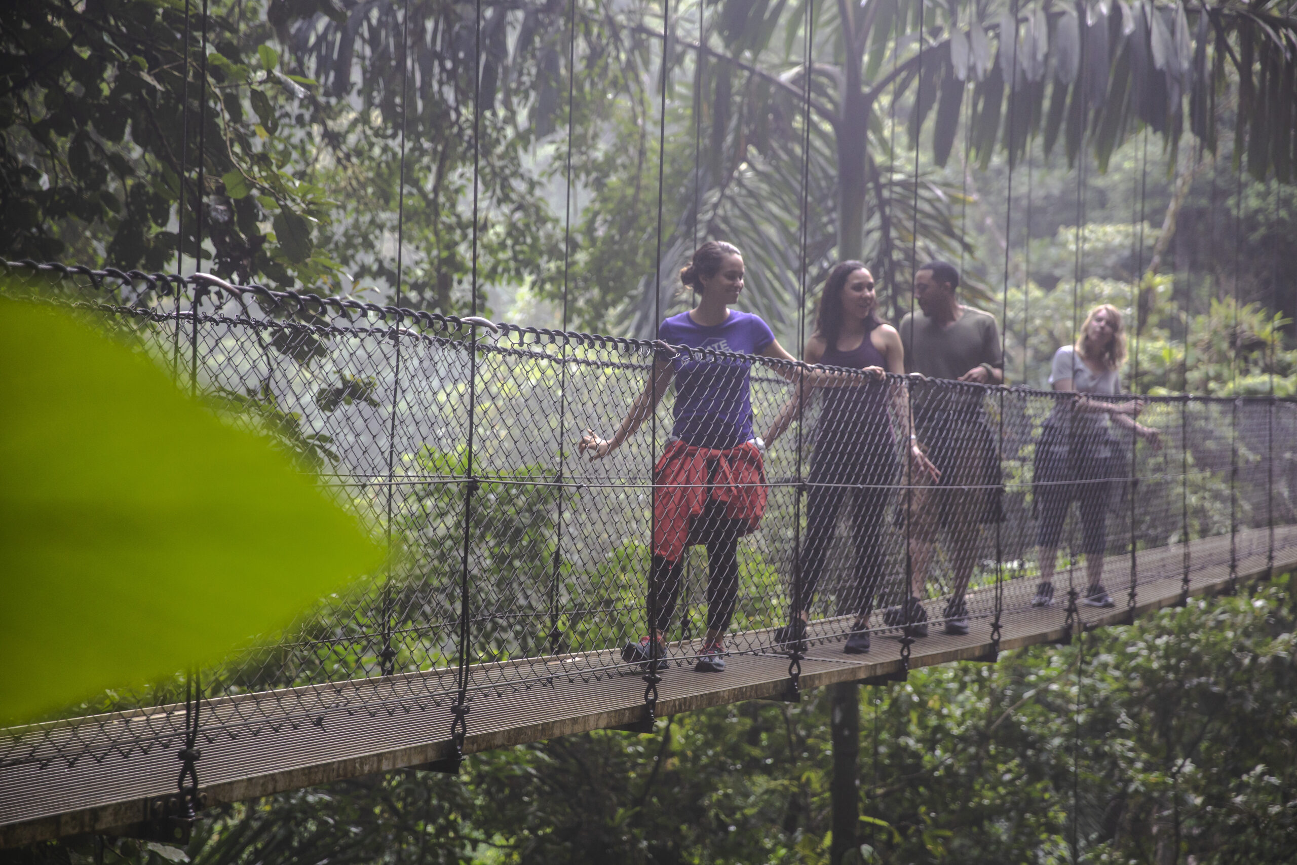 Crossing the Costa Rica Fortuna Suspension Bridge led by a G Adventures CEO