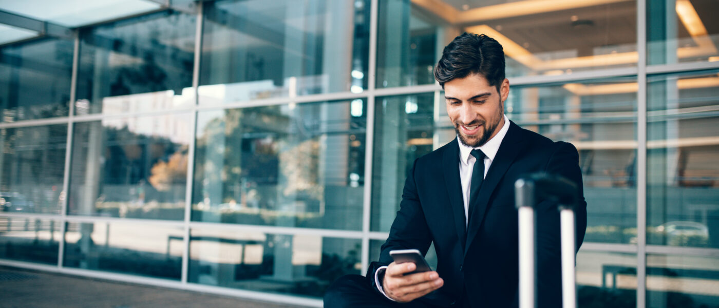 Businessman looking at smartphone