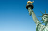 Close up of the Statue of Liberty in New York, USA. Blue sky background with copy space