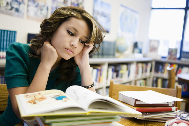 High School Student Studying in Library