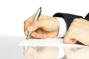 Businessman writes a pen on an empty paper
