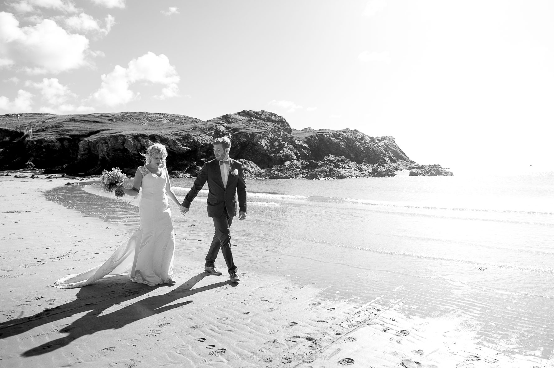 beach picture with the bride and groom after the wedding