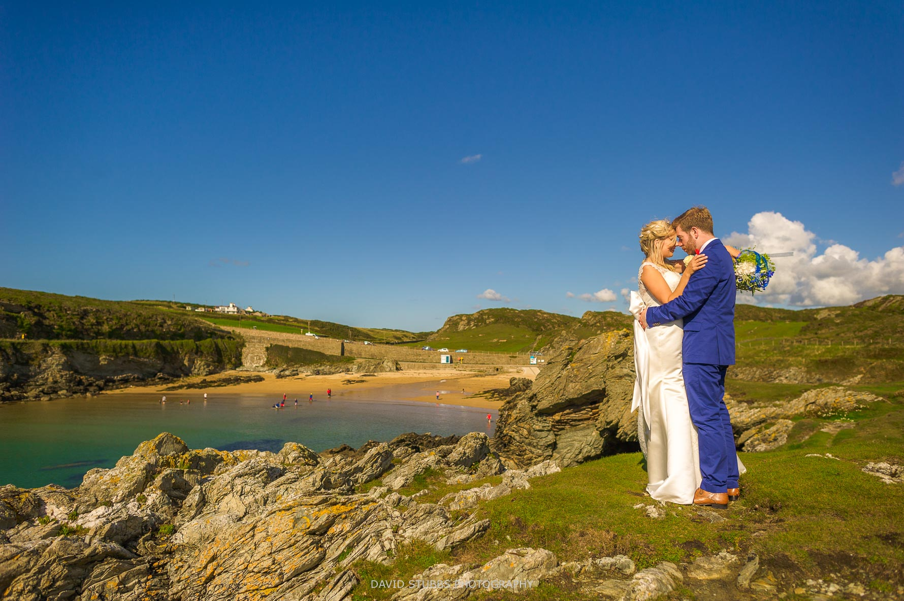 standing on the cliffs for their wedding photos