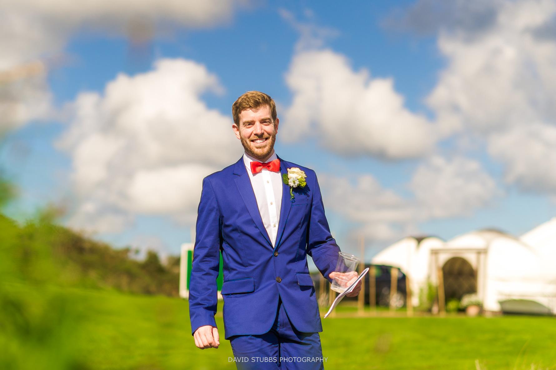 the groom walking along