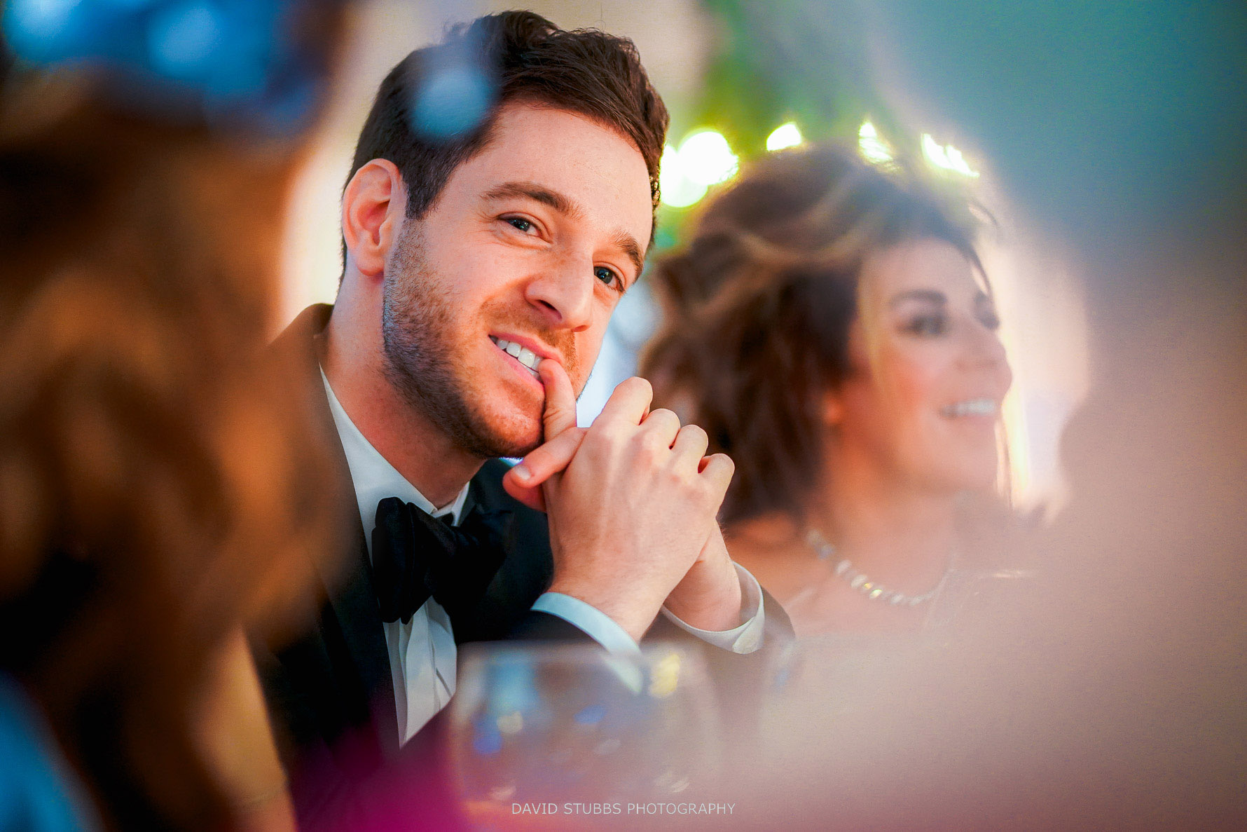 groom biting his nails during the speeches