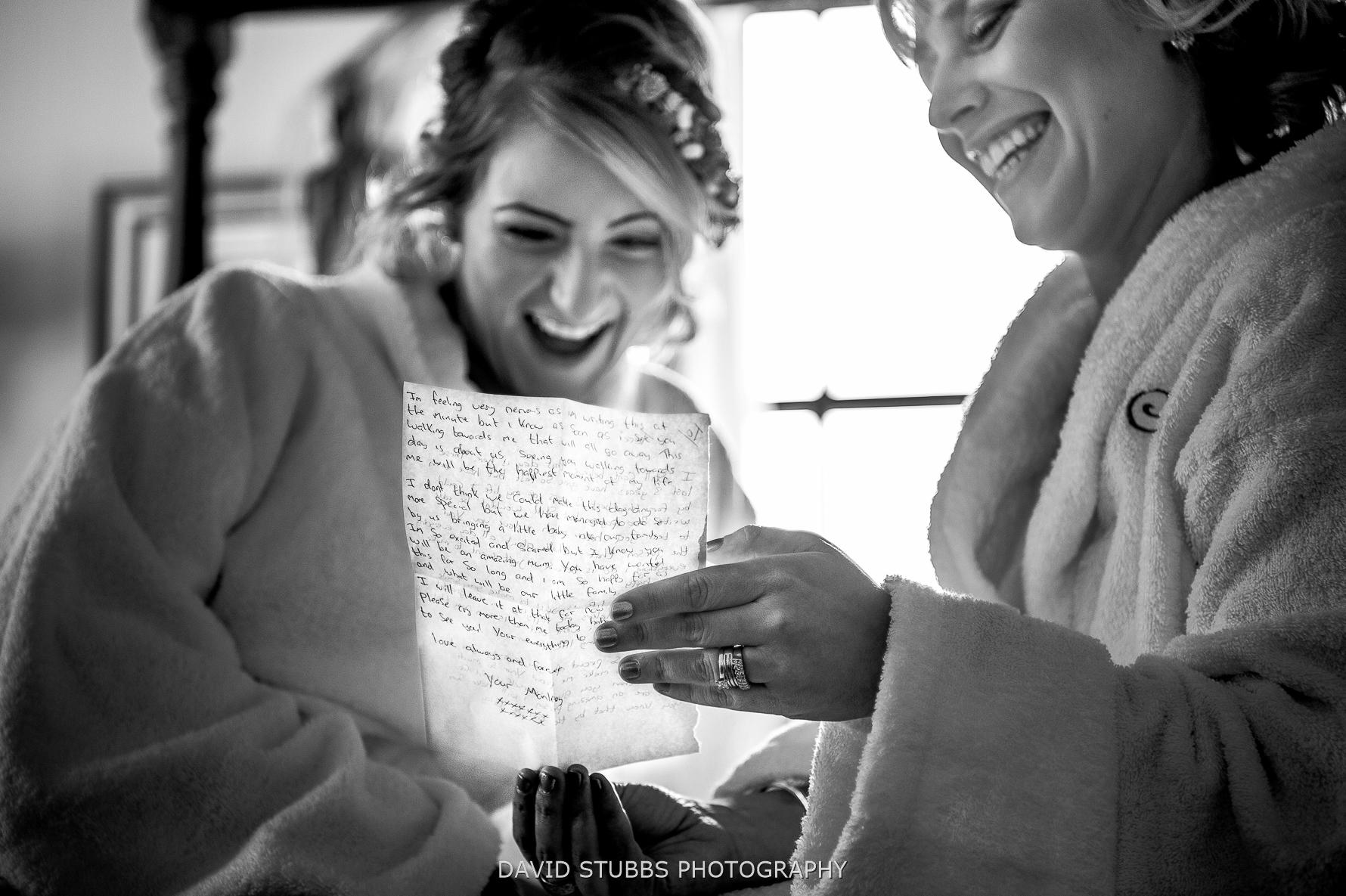 girls laughing reading letter