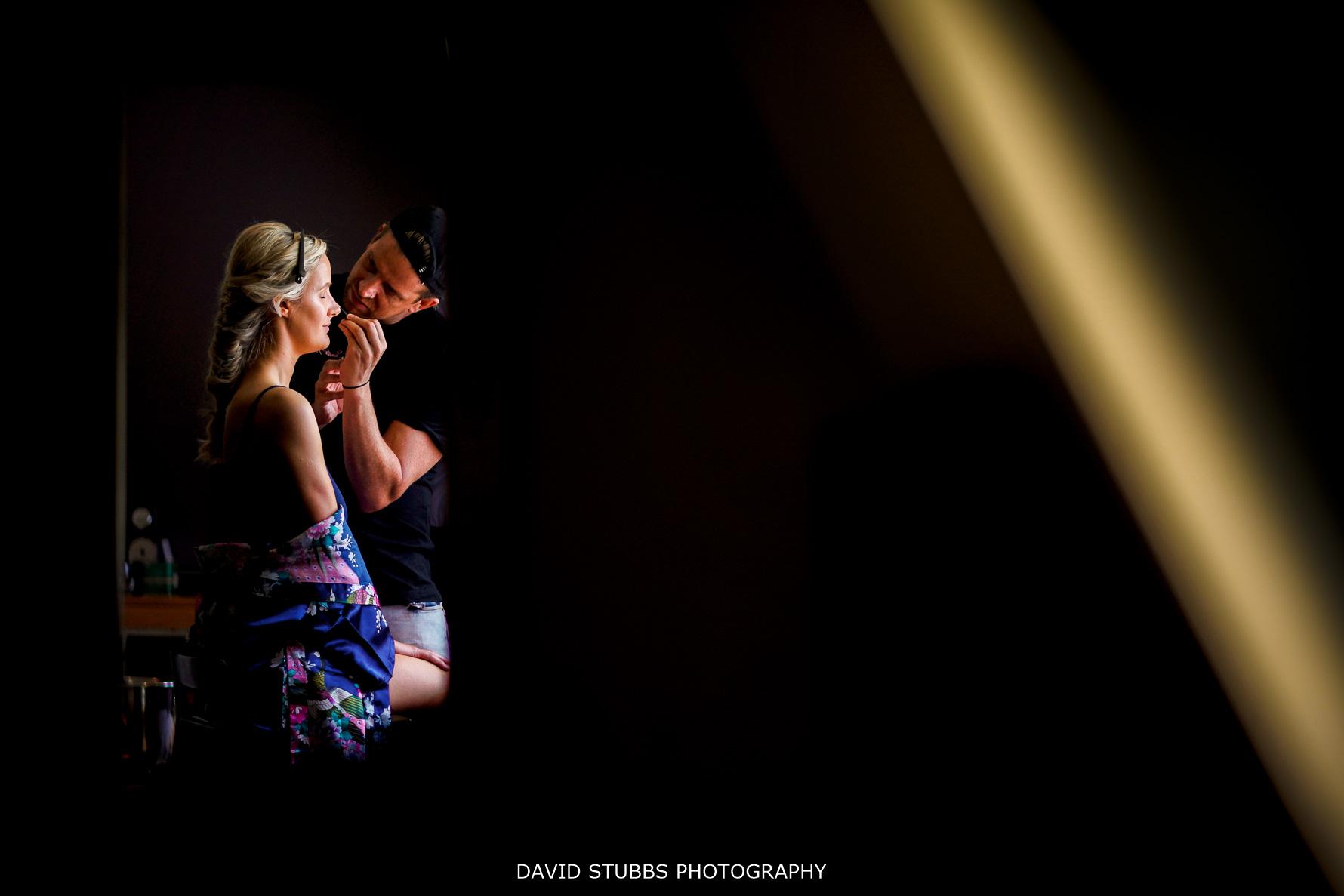 low-key photo of bride in window light