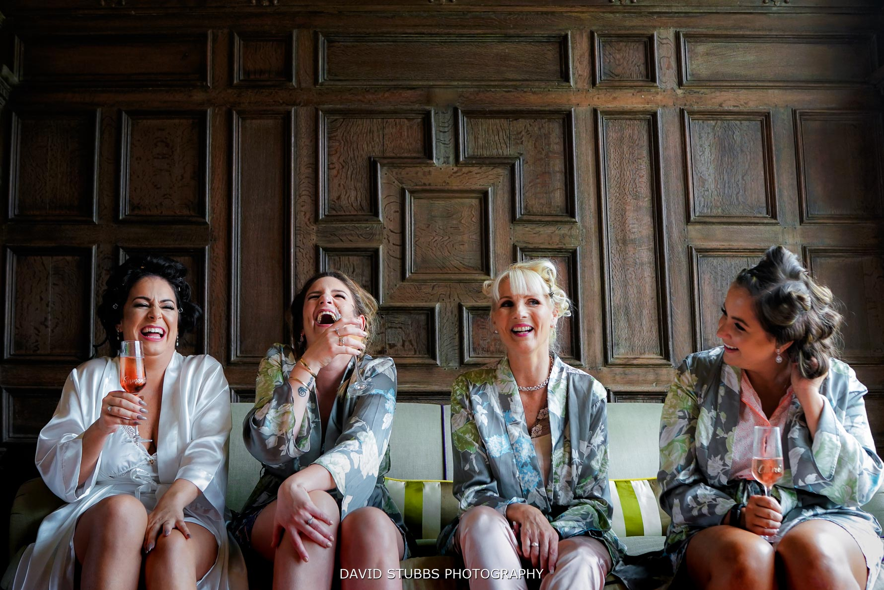 bridesmaids laughin together low angle
