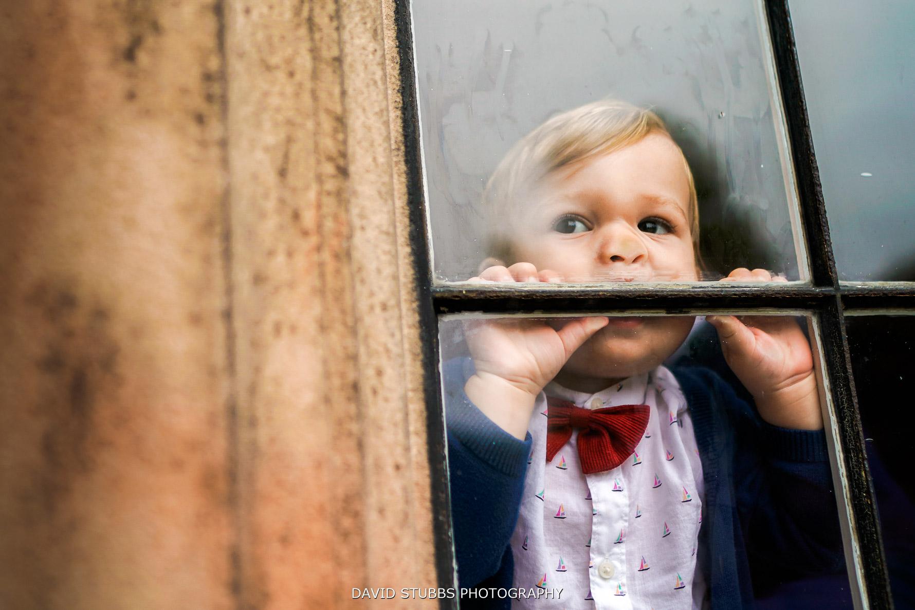 kid squashing face into window
