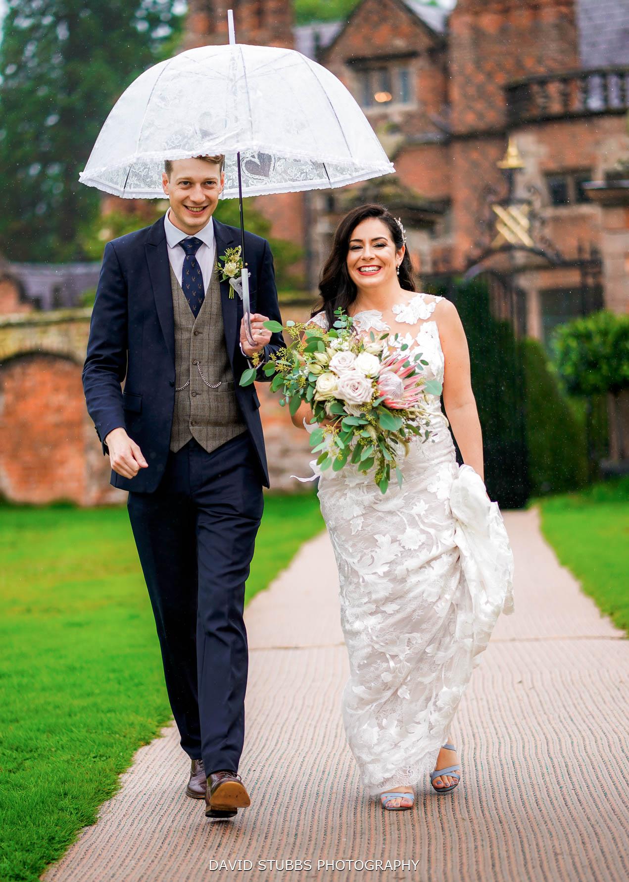 walking together to wedding breakfast in portrait