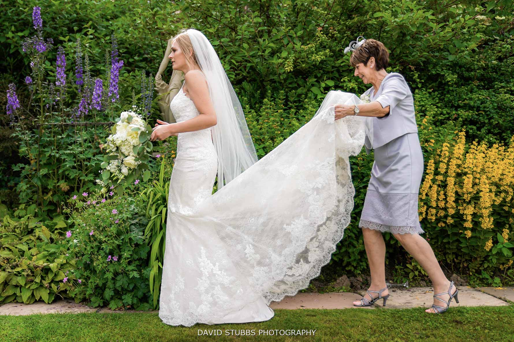 carrying the wedding dress